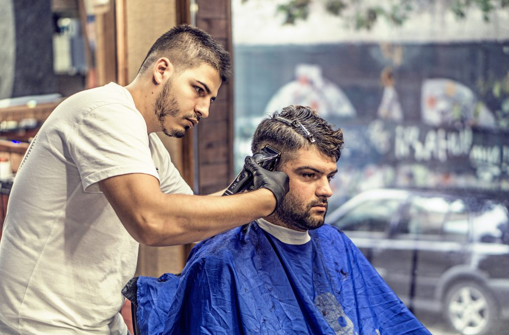 How did a barber respond to new competition?